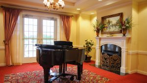 Lobby piano and fireplace