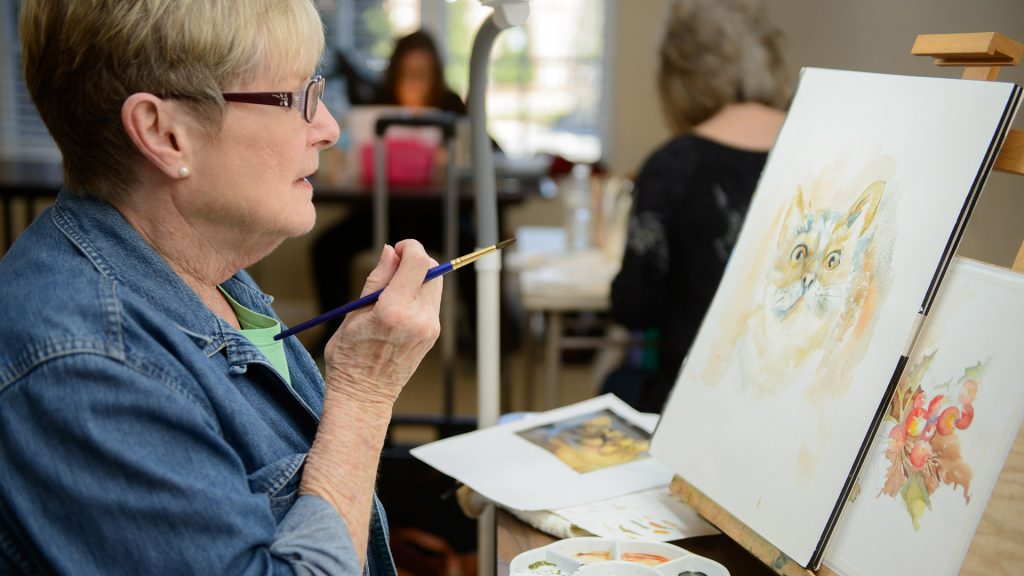 D'Ann Gunn painting a watercolor cat