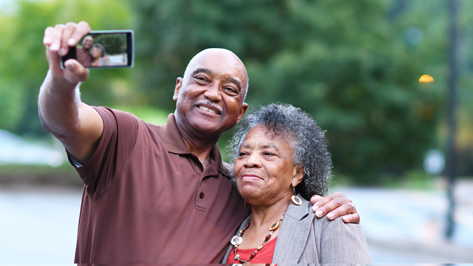 Two elderly people taking a selfie
