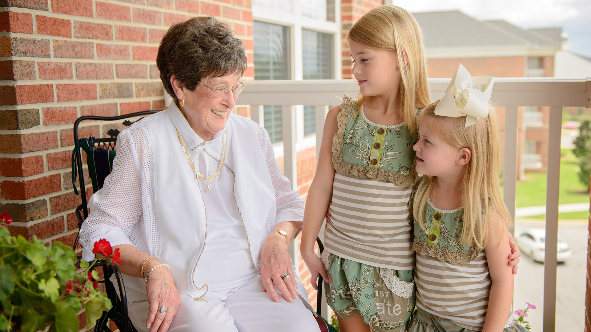Three generations of women pose together at Capstone Village