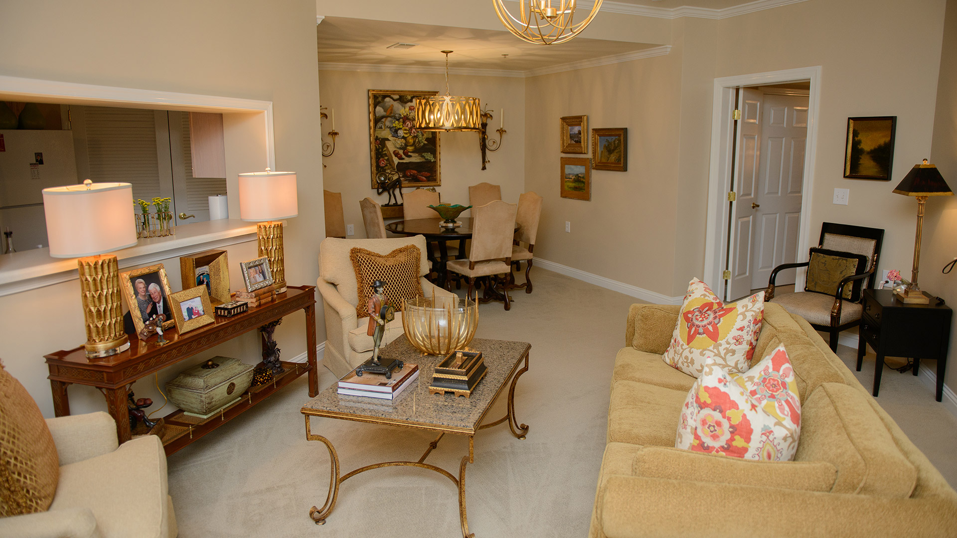 Capstone Village living and dining rooms decorated with lamps, sofas, armchairs and a dining room set