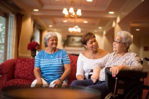 Three African American ladies talking in the lobby