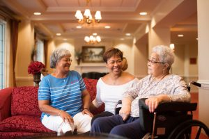 Three African American ladies laughing