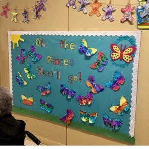 A school hallway board filled with butterflies