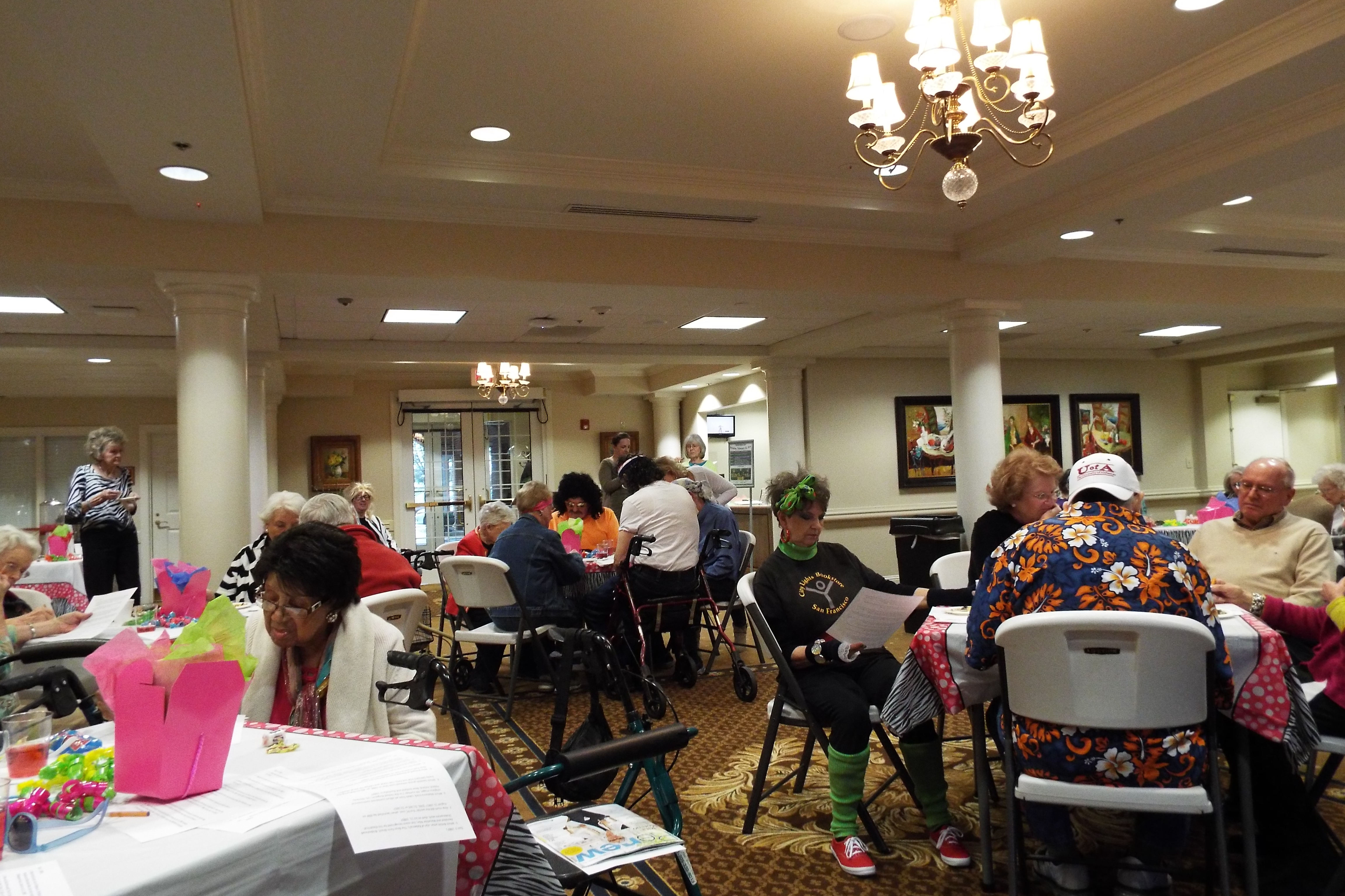 Residents at tables doing activities