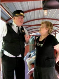 A woman on the train speaks with a conductor