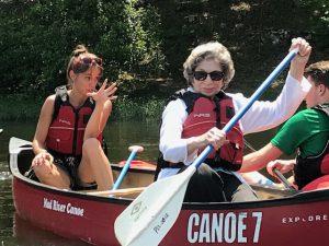 Two women paddling in a canoe
