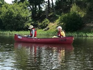 Side view of two people in a canoe
