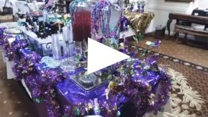 mardi gras party table filled with drinks